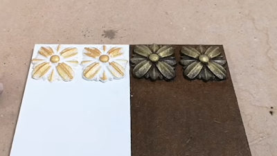 عينات من مجسمات مصنوعة من عجينة الخشب على شكل ورود