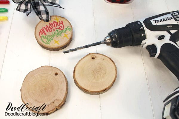 Then use a drill and bit to pilot a hole through the wood slices.