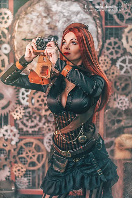 Woman wearing steampunk clothing (corset, blouse, skirt, boots)