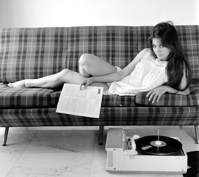 Claudia Cardinale with records and record player