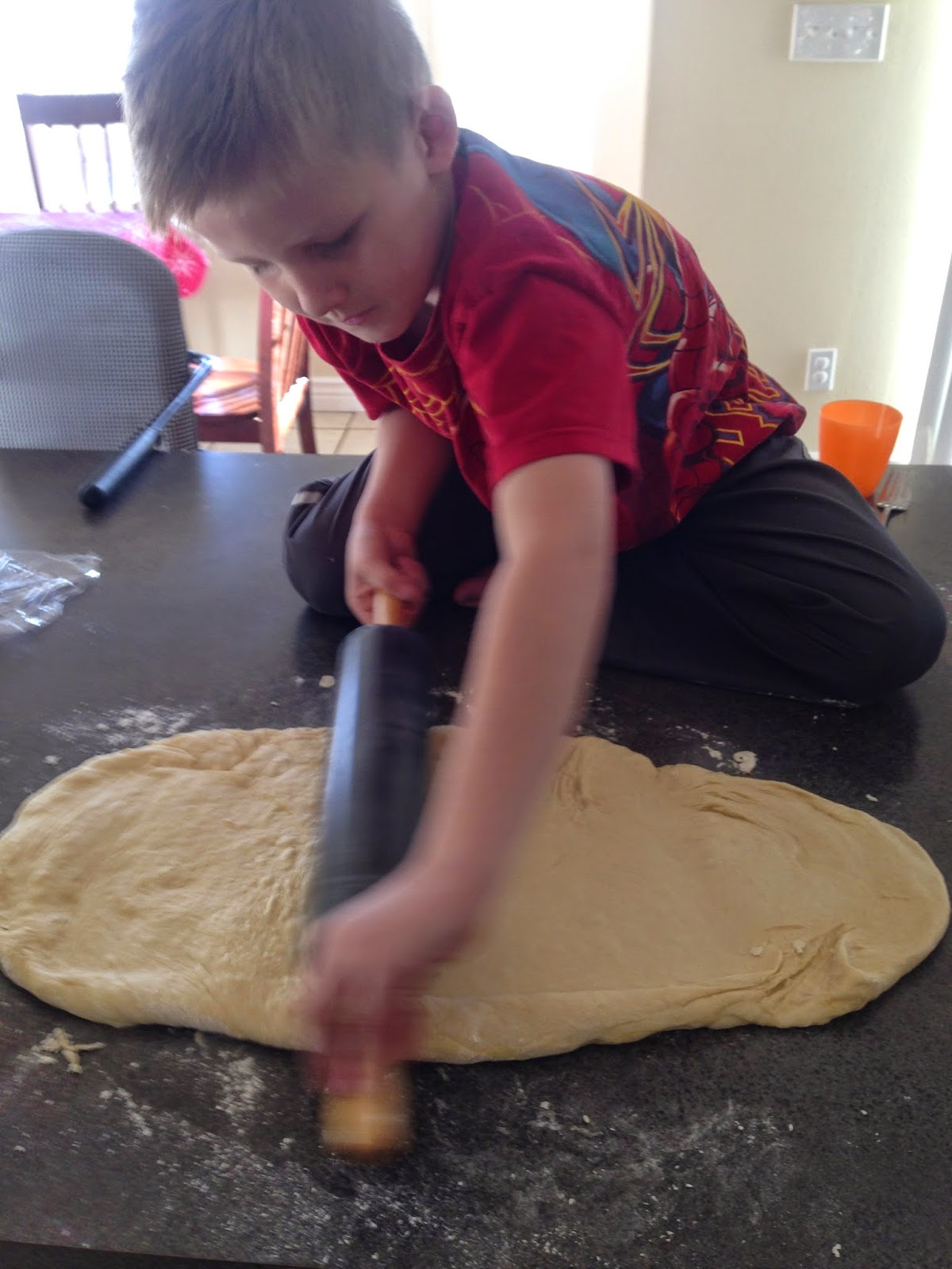 My little guy rolling the dough