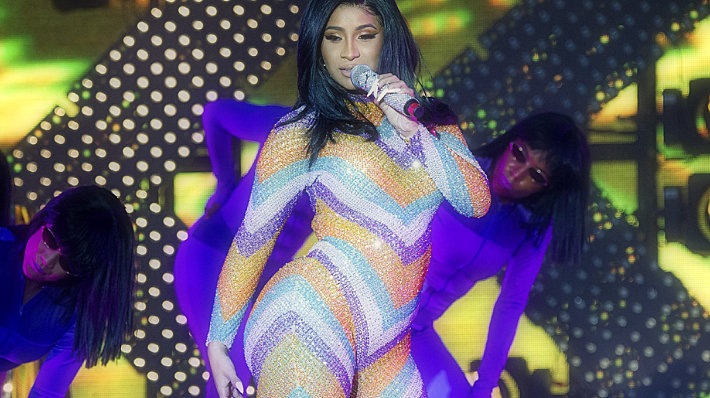 Cardi B takes off the twerking jumpsuit, is done in a bathrobe in Bonnaroo