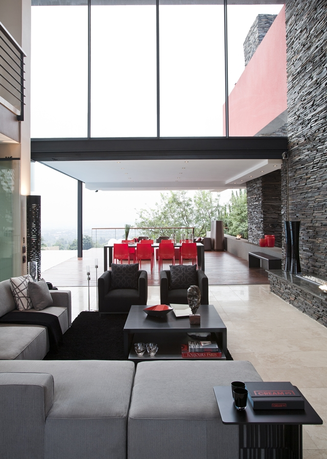 Picture of modern living room with the fireplace and exit to the covered terrace