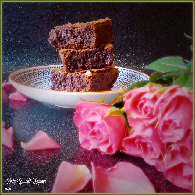 Rich Chocolate Brownies containing hidden rolos perfect for Valentine's Day