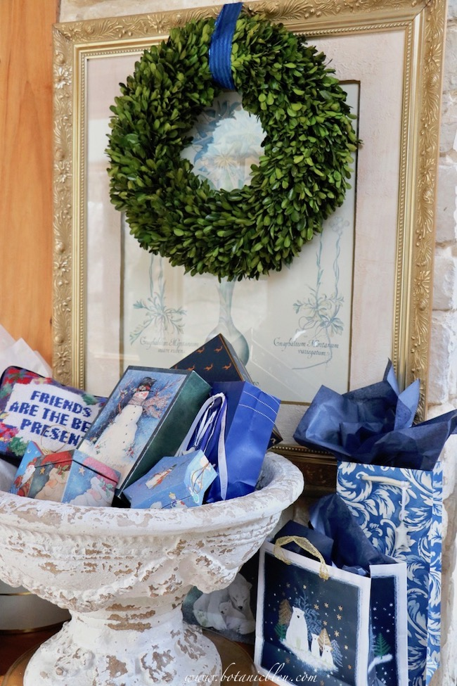 French country blue Christmas presents can be wrapped in blue and white bags without specific Christmas themes