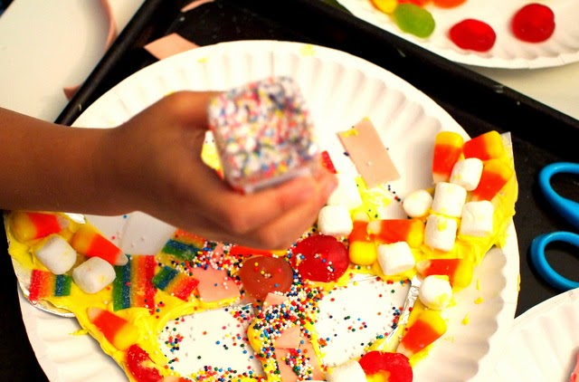 pouring on candy to create candy kids art