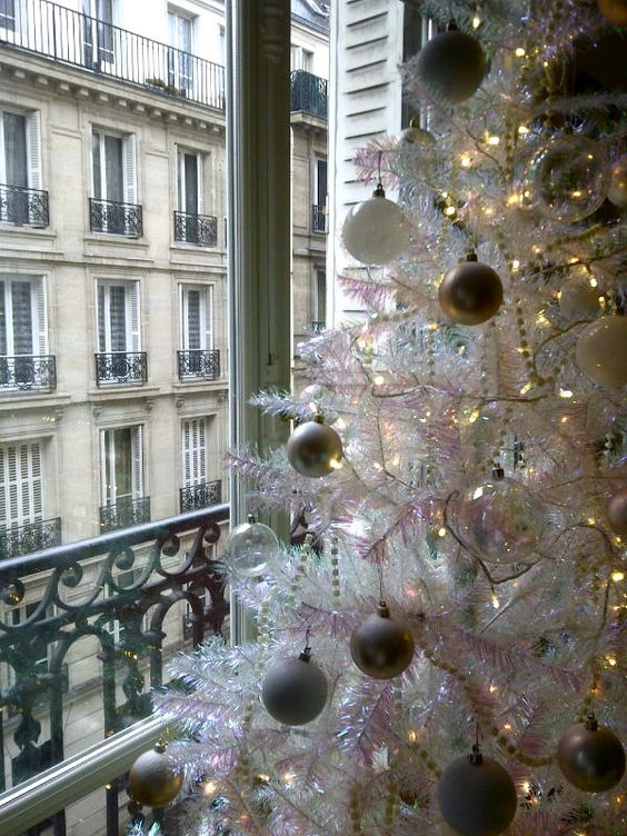 Paris Christmas decor with white tree near French balcony #FrenchChristmas #whiteChristmastree #ParisChristmas