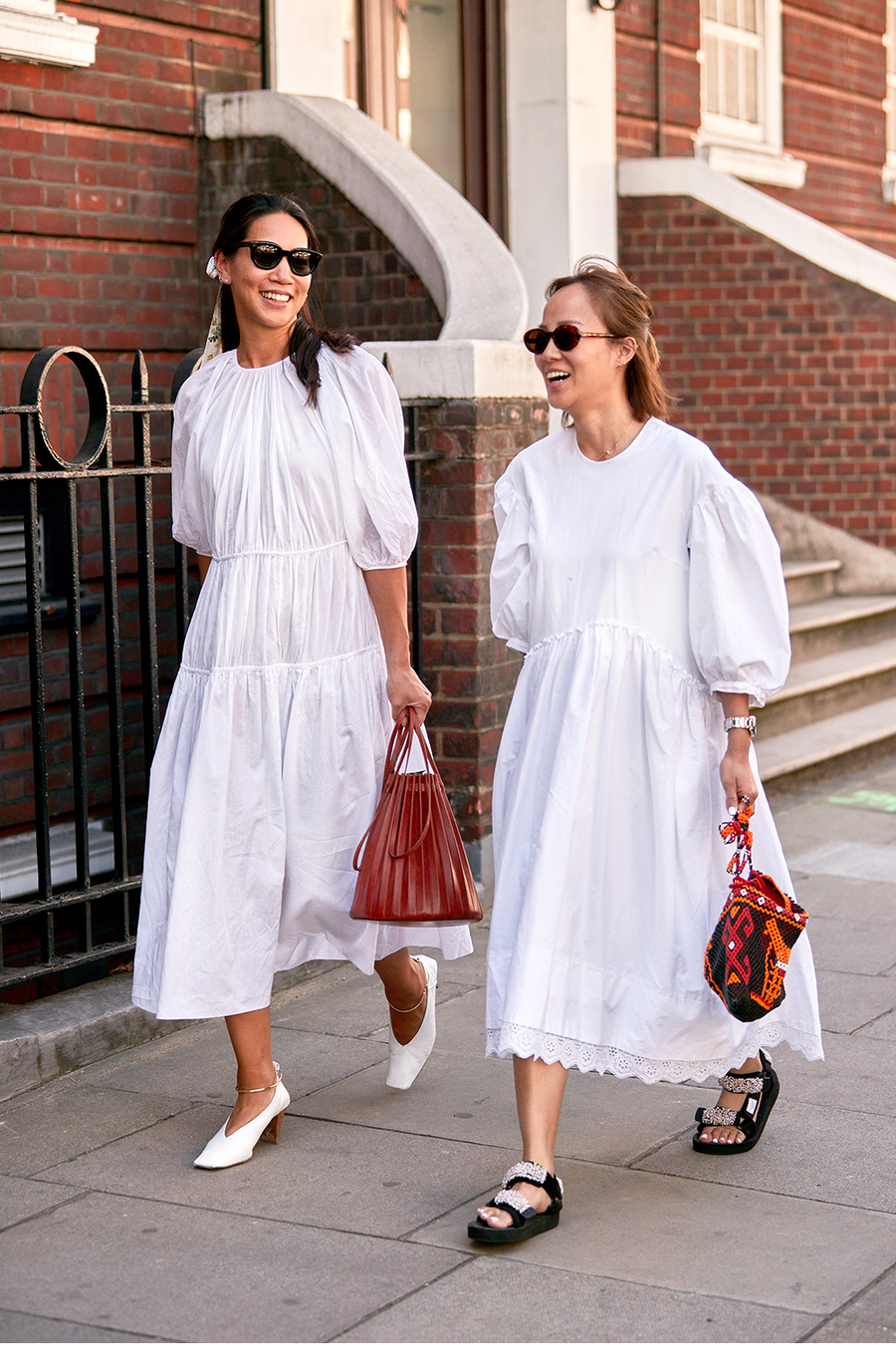 25 Voluminous White Dresses for Spring and Summer — Street style outfit ideas with puffed sleeves and billowy skirt, mini bag, and sandals