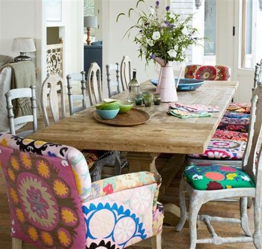 Boho chic dining room with colorful cushions