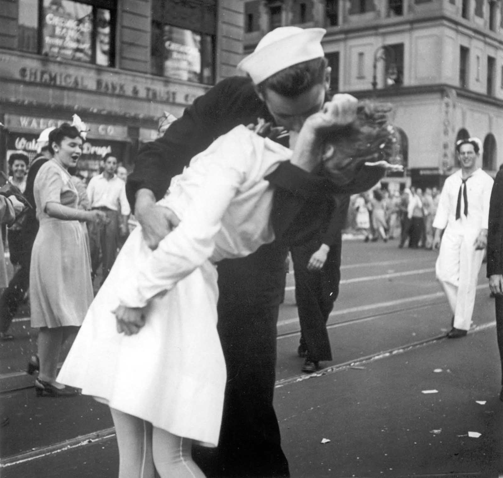 A sailor and a nurse kiss passionately in Manhattan's Times Square, as New York City celebrates the end of World War II on August 14, 1945.