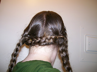 Front braids pinned across the back of the head.