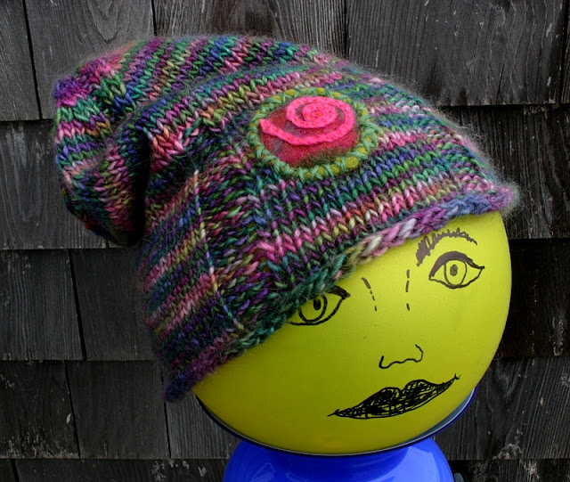 Multi-color Pink Green Slouchy knit Spiral Hat designed by Minaz Jantz