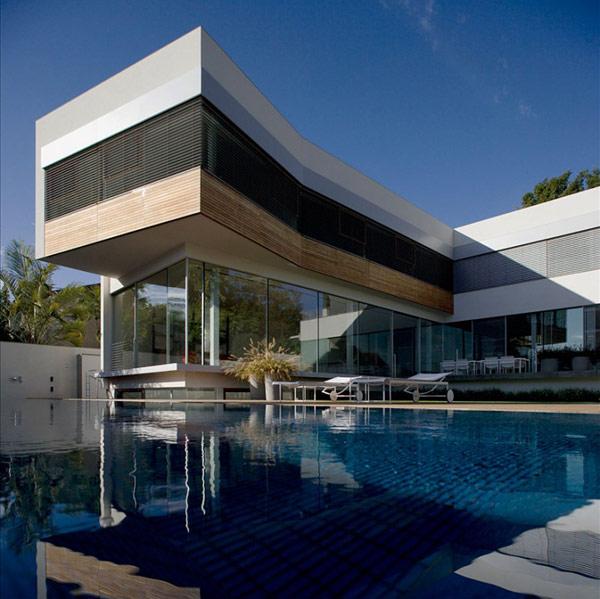 Hogares frescos casa contempor nea de dos niveles en for Casa minimalista con piscina
