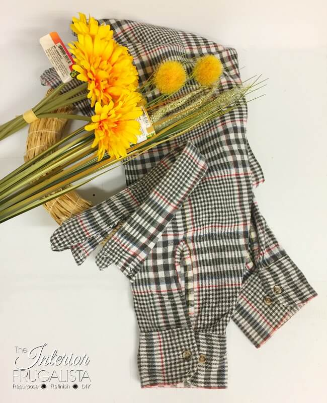 How to make an easy fall wreath with recycled flannel shirt sleeves and dollar store fall floral picks. Even the shirt collar is a wreath hanger!