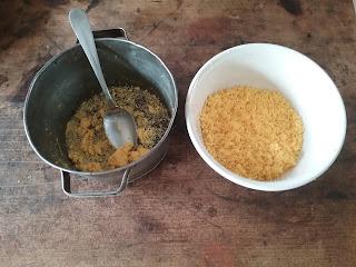 A sieve full of egg yokes and a bowl of fine yoke grains