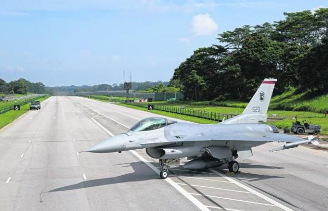 This F16 fighter aircraft can took off and landed along the a temporary aircraft runway on Lim Chu Kang Road.