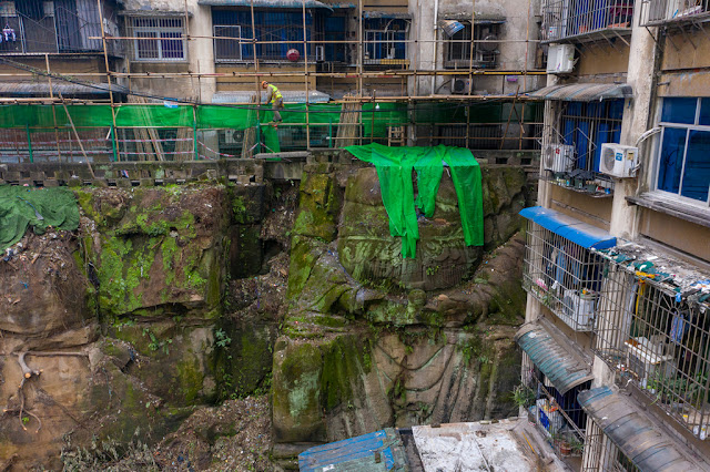 Huge headless Buddha statue found propping up apartment block in China
