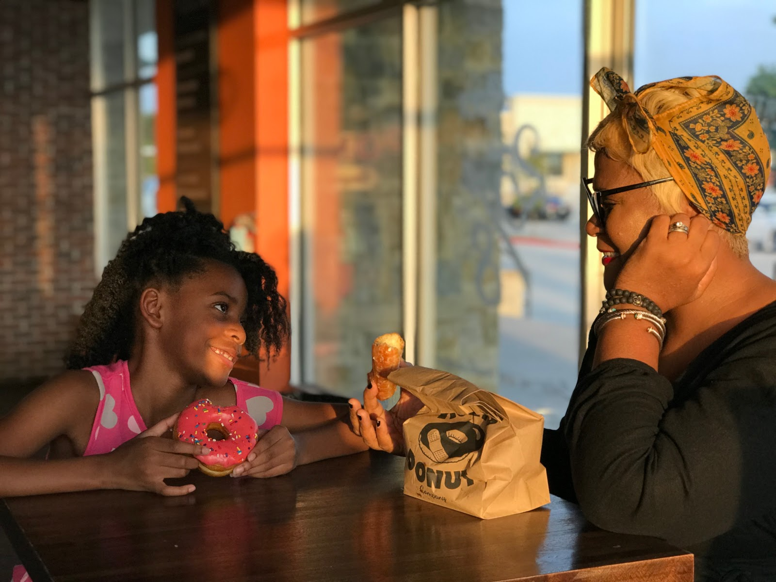 Image: Woman{ Tangie Bell and Daughter Moriah at Hurts Donuts in Frisco, Texas. Picture taken by Shacarey Martin. Seen First  on Bits and Babbles blog