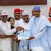 Buhari accepts donated nomination form, slams APC defectors