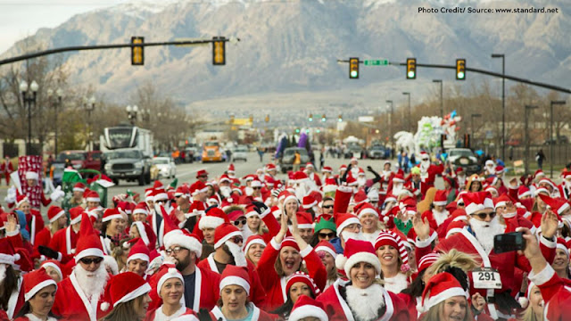 a group of runners dressed as Santa, on the course
