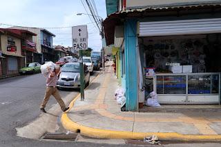 man with bag in Santiago de Puriscal