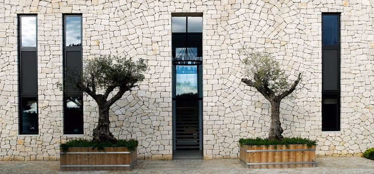 Modern luxury exterior stone house minimal sophisticated interior design by Piet Boon