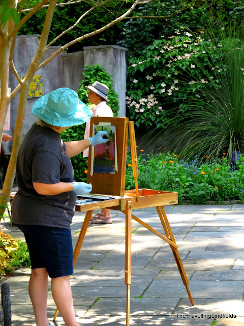 Artist painting at Chanticleer Garden