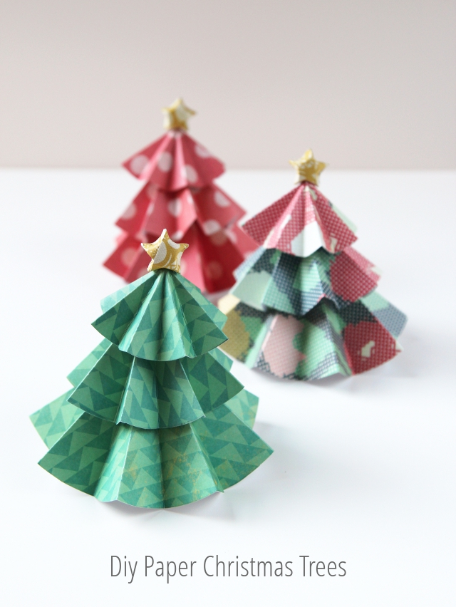 Diy paper christmas trees topped with origami stars for How to make paper christmas decorations at home