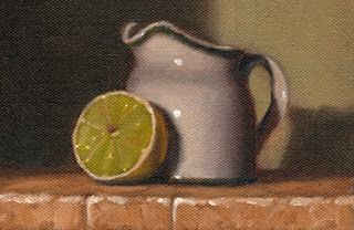 Oil painting of a lime cut in half resting on a small white porcelain milk jug.