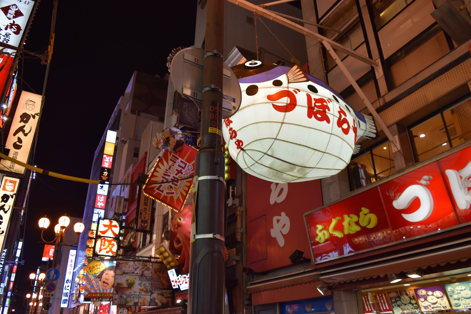Neon signs and crowds in Dotombori,, Osaka at night