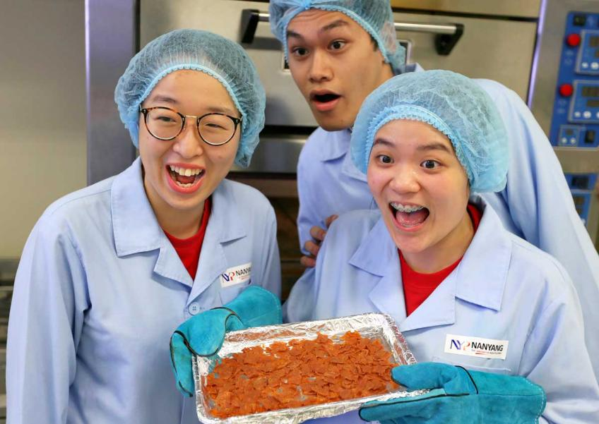 (L to R) Students Lai Xue Er, Muhammad Haziq Bin Md Hasan and Danice Peh Yan Ling from Nanyang Polytechic have developed a healthier version of bak kwa.