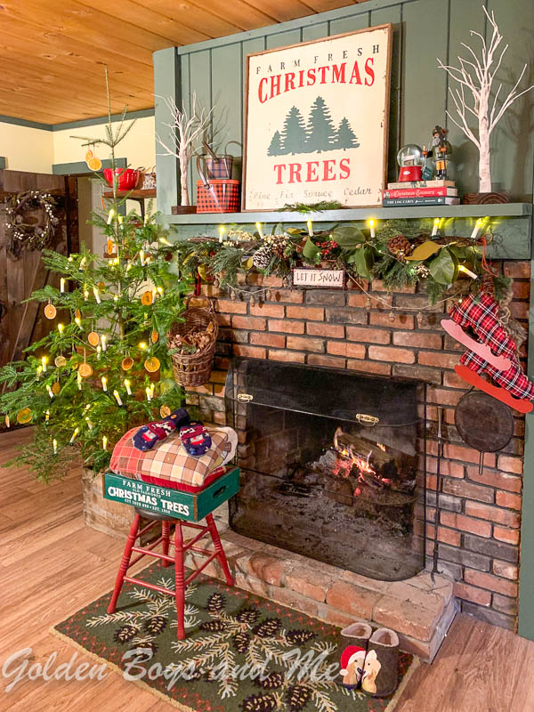 Brick fireplace with Benjamin Moore Backwoods painted mantel with Christmas decor - www.goldenboysandme.com