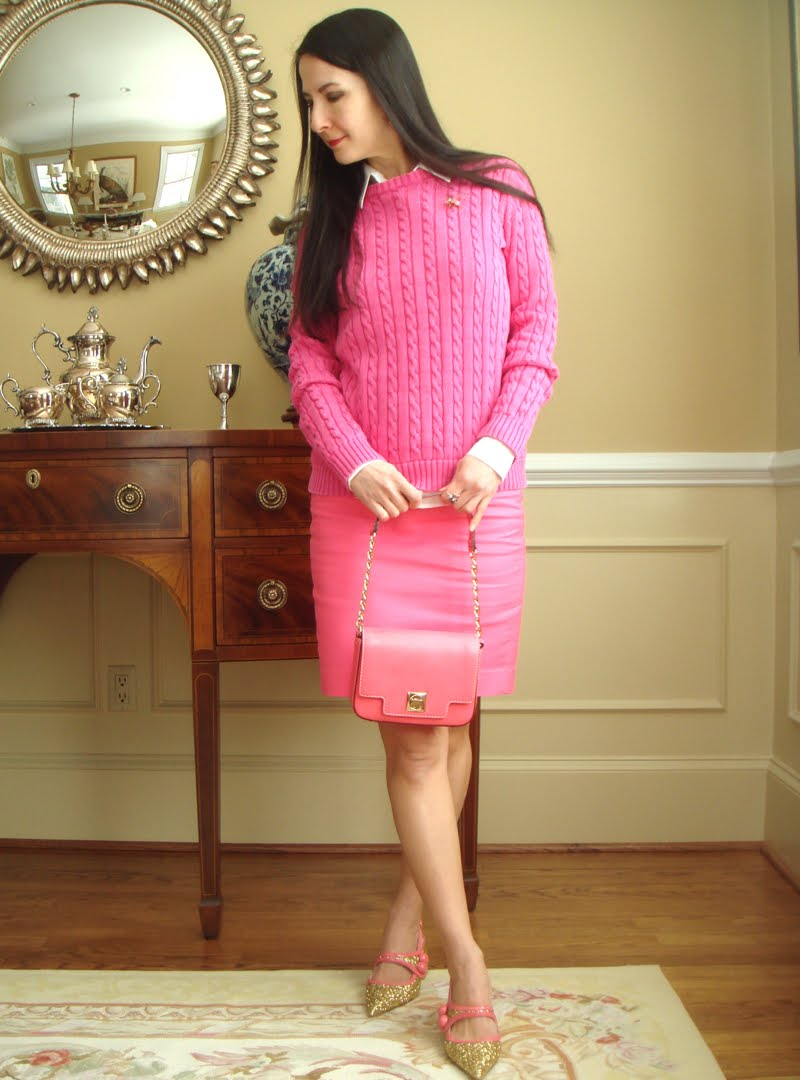 Wearing pink outfit head turned to side and wearing gold glitter shoes with pink trim.