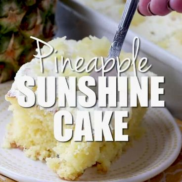 This Pineapple Sunshine Cake is a light and fluffy pineapple-infused cake, topped with a sweet and creamy whipped cream frosting.