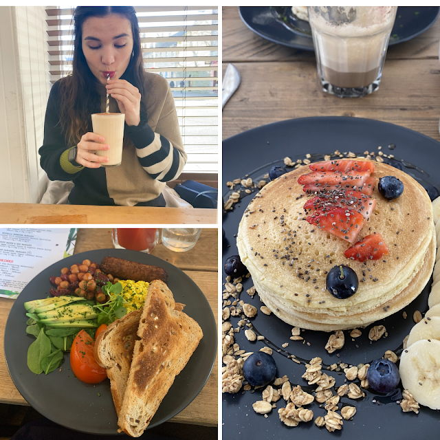 Layout of 3 photos. The top left is myself drinking a milkshake., The bottom left is vegan full English breakfast (toast, beans, sausages, avocado and tomato). The main photo is stack of pancakes topped with granola, syrup, banana and blueberries