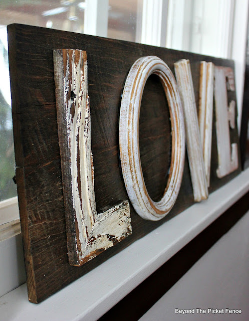 A farmhouse style love sign made from barn wood for valentines day or a wedding