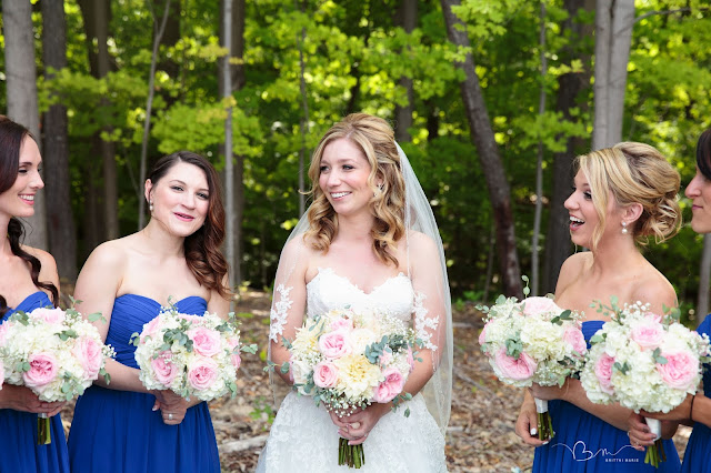 bridesmaids laughing at Noah's Event Venue in Auburn Hills Michigan