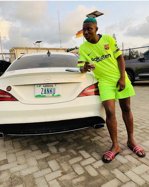 zlatan-ibile-house-and-cars-Zlatan-leans-on-his-brand-new-Mercedes-Benz-CLA-class-with-Zanku-plate-number