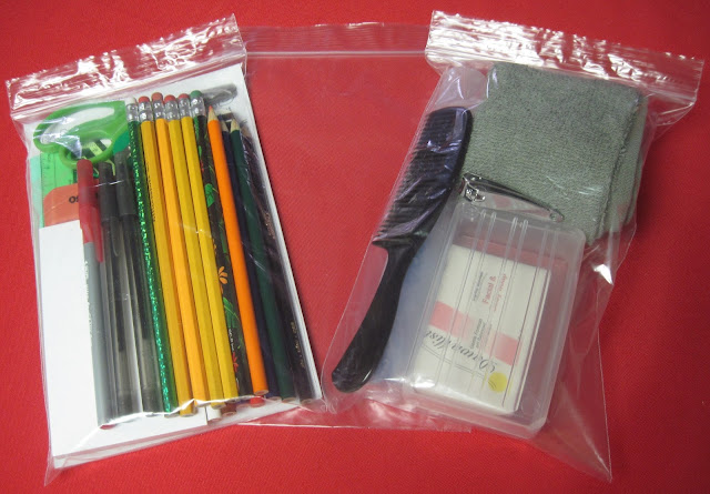 School and hygiene supplies in zipper bags for Operation Christmas Child shoeboxes.