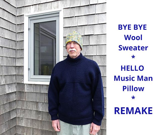 Hand knit dark blue sweater by Minaz Jantz