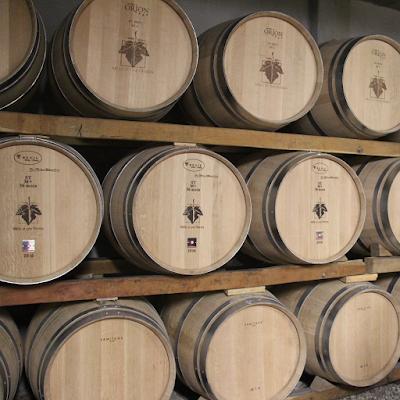 Oak barrels in the cooperative cellar.