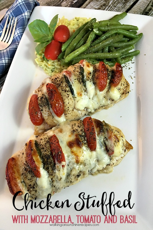 Hasselback Chicken stuffed with tomatoes, cheese and basil from Walking on Sunshine Recipes.