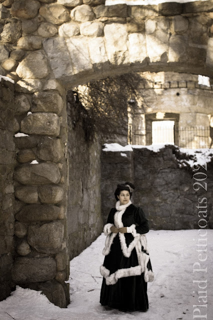 the author in her finished ensemble among stone walls and snow