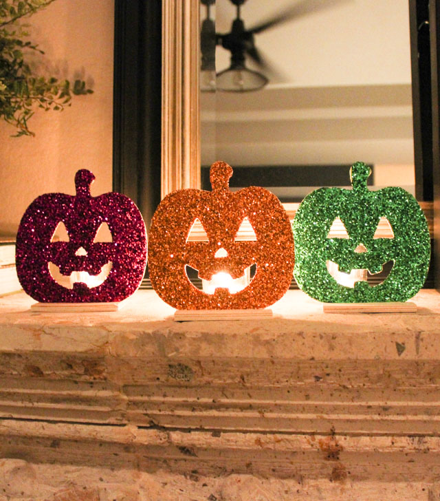 Make these glittery jack-o-lantern lights with a wood pumpkin and votive!