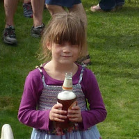 girl holding bottle of beer, badger ales