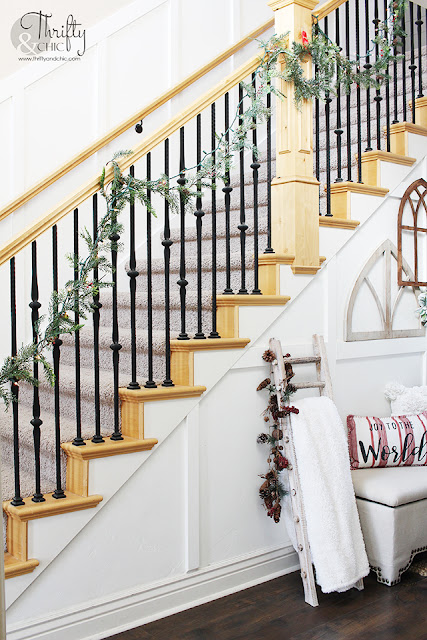 Entryway Christmas decorating ideas. Farmhouse Christmas Entryway decor. Board and batten entryway. Two story entryway ideas. Hanging garland on a banister or stairs.