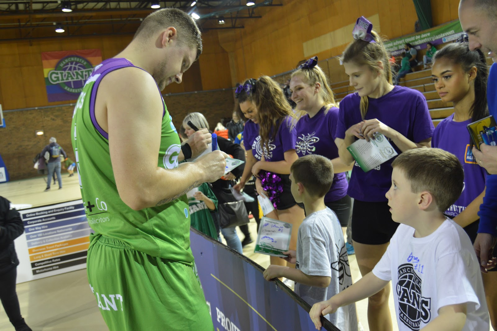 a basketball player signing an autograph