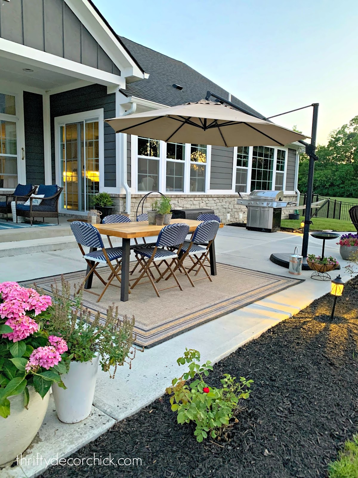 Back patio with umbrella, table and fire pit