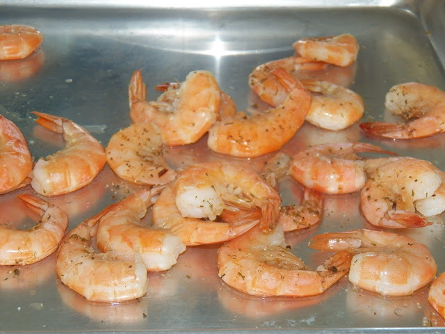 Cooked Shrimp cooling on sheet