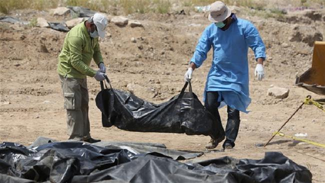 Forensic teams exhuming more remains at mass graves in Iraq's Tikrit
